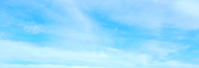 Beautiful blue sky with white fluffy clouds background. Turquoise color blured photography