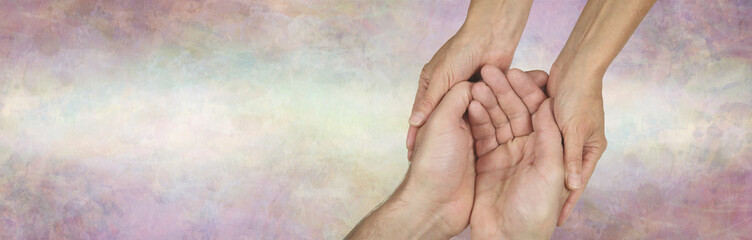 Caregivers Campaign background banner - female hands gently cupped around male cupped hands against a wide subtle multicoloured banner with copy space