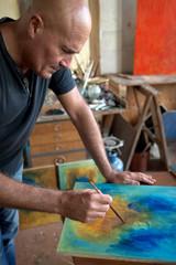 Pittore, artista al lavoro