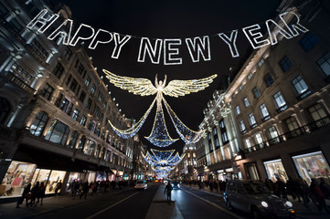 Happy New Year Message with lights twinkling in the night sky above Regent Street, in London