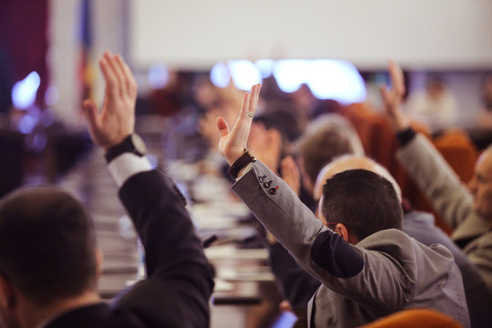 Members of Parliament voting by raising hands