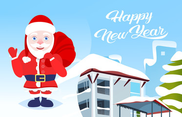 waving santa chaus hold present sack happy new year merry christmas holidays concept winter snow covered house cityscape background flat horizontal