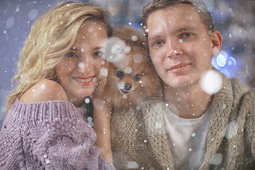 New Year's photo people / young man and girl in the Christmas interior, cozy decorated house