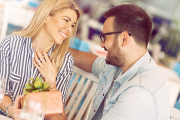 Happy woman  receiving gift, love, romance, valentine's day, couple
