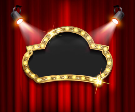 Theater sign on curtain with spotlight.