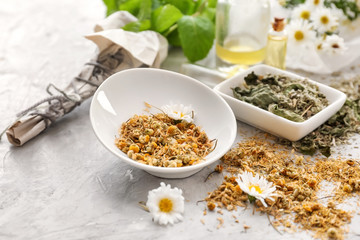 Aromatic dried flowers with herbs on light table