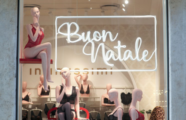 "A sign reading ""Happy Christmas"" is seen at an ""Intimissimi"" women's underwear shop in downtown Rome"