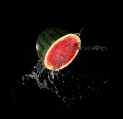 Sliced Watermelon with water splash flying in the air,Stop motion