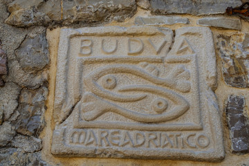 relief on a stone a symbol of fish Montenegro budva