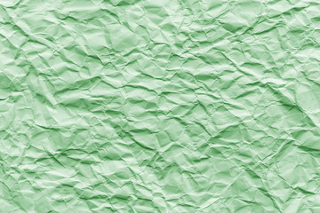 Texture of green wrinkled paper