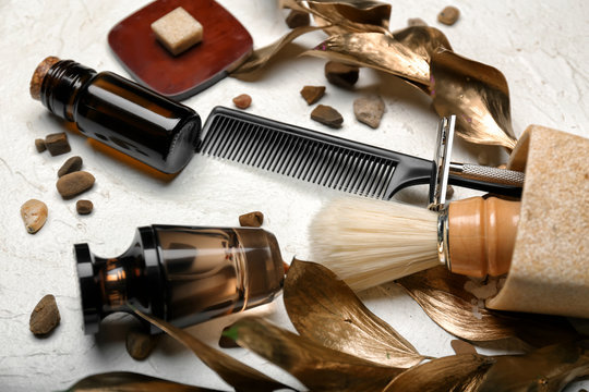 Composition with shaving accessories for men and cosmetics on white background
