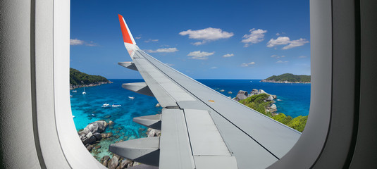 View from airplane. Flight window. Vacation destinations. Tropical beach. Travel concept. Fototapete
