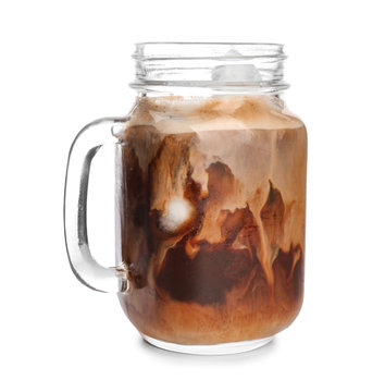 Mason jar of cold coffee on white background