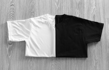 Color t-shirts on wooden background