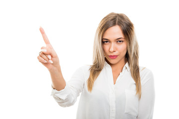 Young pretty business woman showing denial gesture