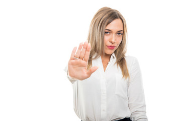 Young pretty business woman showing stop gesture