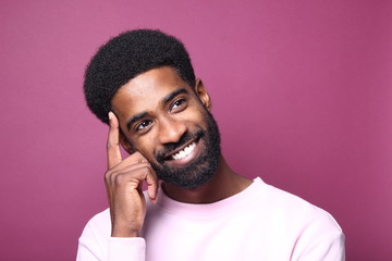 Beautiful black man in front of a colored background