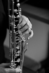 Fototapete - The hand of a musician playing the bass clarinet closeup in black and white