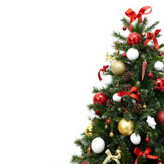 Fragment of a beautiful christmas tree with colorful decorations, cones, balls and ribbons, isolated on white