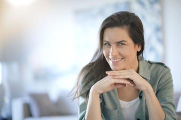 Portrait of stunning brunette smiling indoors