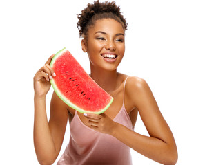 Lovely girl holding red ripe watermelon slice. Portrait of smiling african american girl isolated on white background. Healthy & Happy
