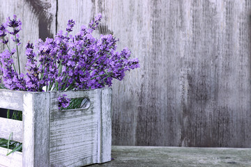 Keuken foto achterwand Lavendel Lavender flowers  in box on wooden background