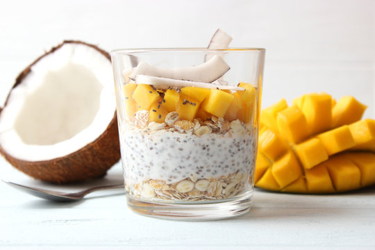 chia pudding with mango, coconut and granola. Proper nutrition, superfood. Healthy breakfast, dessert.