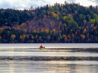canoeing on lake in autumn