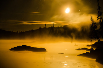misty moonrise on lake