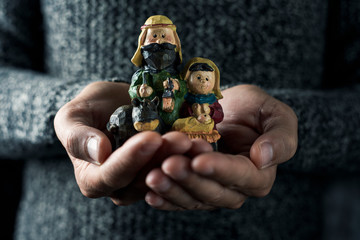 the holy family in the hands of a man