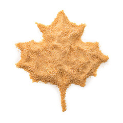 Maple leaf made with granulated sugar on white background