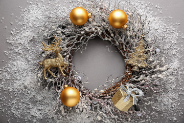 Beautiful Christmas wreath on grey background
