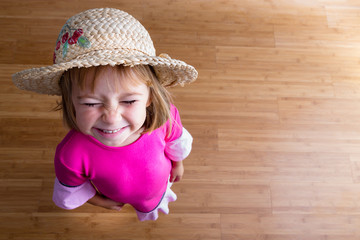 Young girl in straw hat from above
