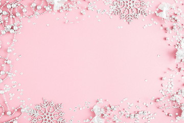 Christmas elegant modern composition. Xmas silver decorations on pastel pink background. Christmas, New Year, winter concept. Flat lay, top view, copy space