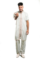 A full-length shot of a Arabic young man wearing typical arab clothes presenting and inviting to come on isolated white background