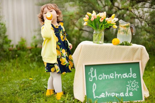 toddler girl selling lemonade