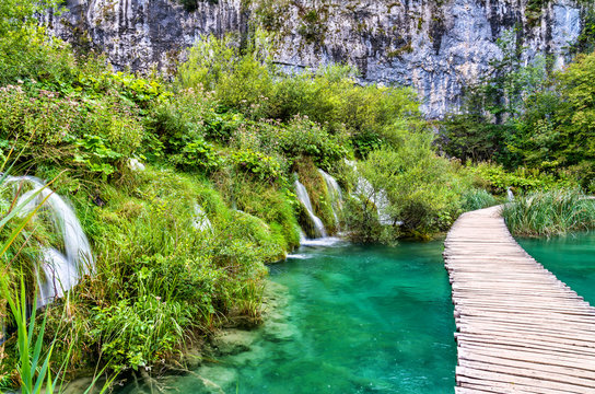 Wooden pathway above water at Plitvice National Park in Croatia