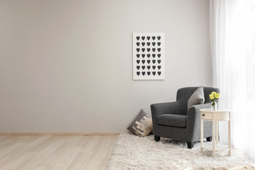 Interior of light room with cozy armchair near window Wall mural