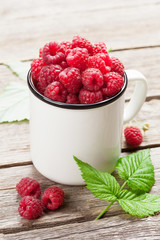 Cup of ripe raspberries
