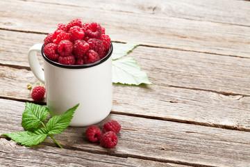 Cup of ripe raspberries