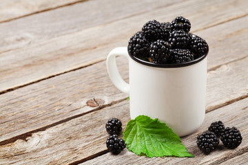 Cup of ripe blackberries