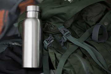Insulated Stainless Bottle with camping equipment