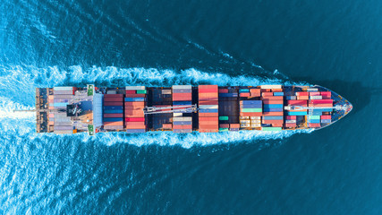 Obraz Aerial top view full speed container ship in the sea for logistics import export, shipping or transportation concept. - fototapety do salonu