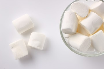 Marshmallow in a plate on a white background