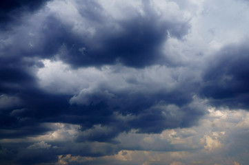 sky with white fluffy and rainy dark clouds after rain. Background texture.