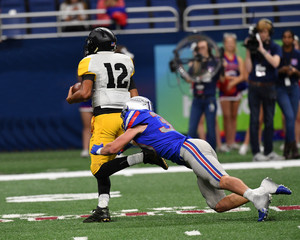 Great action shots of high school football player making amazing plays during a football game