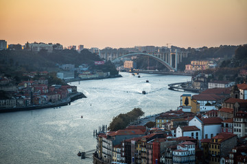 ribeira district at sunset from bridge dom luis