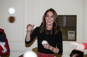 Britain's Catherine, The Duchess of Cambridge, takes part in a Christmas Party for the families of service personnel from RAF Marnham and RAF Coningsby deployed in Cyprus, at Kensington Palace in London