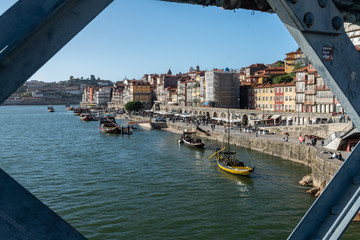 view of ribeira district from dom luise bridge in porto city