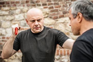 Knife disarm demonstration. Kapap instructor practice self defense knife threat disarming